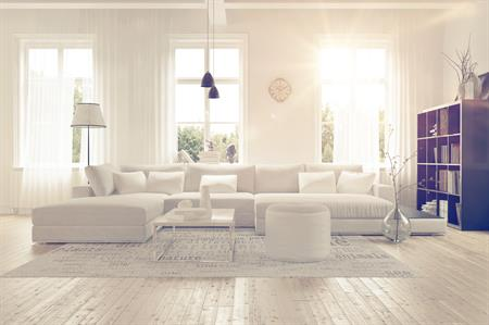 Clean living room with white furniture