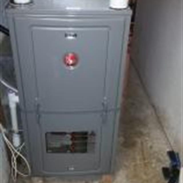 New high efficiency Rheem gas furnace installation.