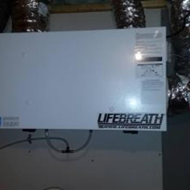 A Lifebreath heat recovery ventilator installation. Keeps the moisture and ice off the windows.