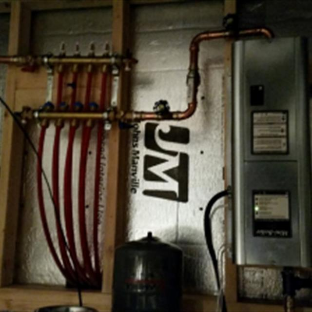 Electric boiler installed in a crawl space for garage radiant floor heat.