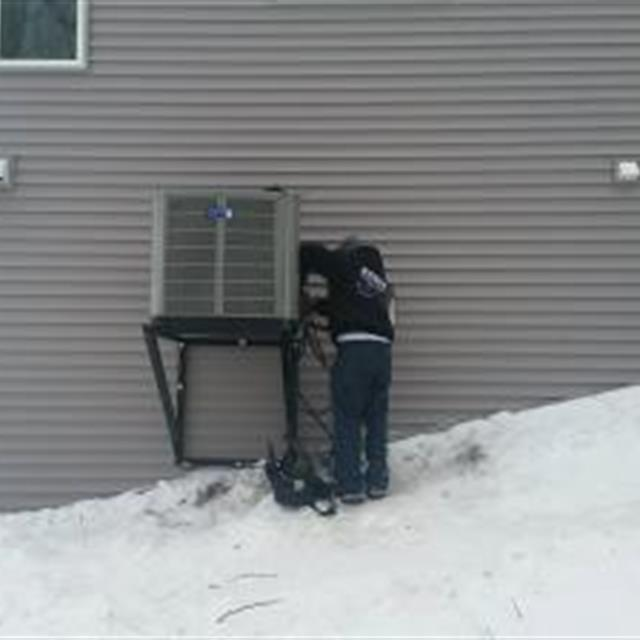 Andy installing an American Standard heat pump on Floyd Lake.