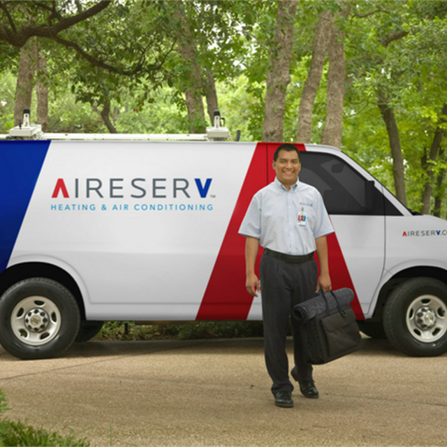 worker in front of aire serv van