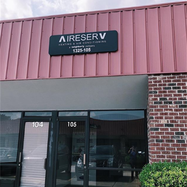 Aire Serv sign on red brick building