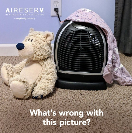 What's wrong with this picture text in front of space heater covered with blanket next to teddy bear