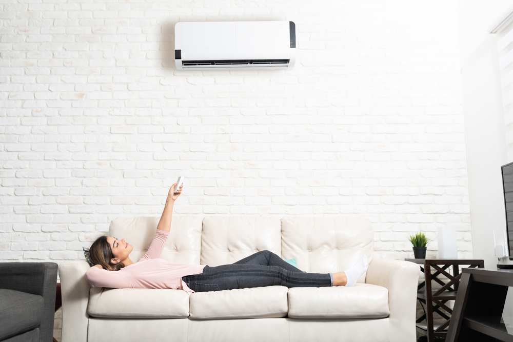 Woman Turning on Her Ductless Mini Split